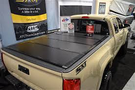 SEMA 2015: ATC Truck Covers Rocks The New SXT Tonneau Cover Truck Bed Covers Northwest Accsories Portland Or Rugged Hard Folding Tonneau Cover Autoaccsoriesgaragecom Used 02 09 Dodge Ram Hard Shell Fiberglass Tonneau Cover For Short 052015 Toyota Tacoma 61ft Standard Rollup Vinyl Amazoncom Tonno Pro 42506 Fold Black Trifold Heavy Duty Diamondback Hd Xmate Trifold Works With 2015 Advantage Surefit Snap Weathertech Roll Up Tyger Auto Tgbc3d1015 Trifold Whats The Difference In Cheap Vs More Expensive