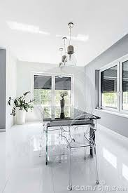 Minimalist Modern Dining Room Designed In White Stock Photo