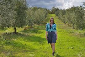 Beautiful Young Country Girl In Olive Garden Tuscan Italy Stock