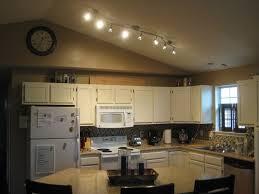 stunning kitchen lighting ideas with wavy stainless steel track