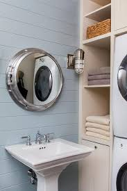 cottage pool house bathroom with blue shiplap walls mounted with a