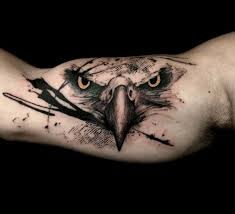 A Bird Of Prey Owns The Spotlight On Bulging Bicep Dot Work And Prominent Black Ink Strewed Across Piece Suggest Graphic Novel Feel