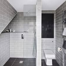 bathroom with grey tile floor peenmedia