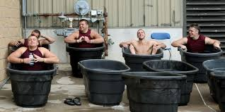 photo gophers football players sitting in horse trough tubs