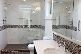 walk in shower in bathroom with pink and brown mosaic tile marble