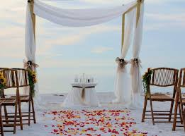 Small Bamboo Tent And Round Table Also Folding Chairs Plus Flower Petals Aisle In Beach Wedding Decoration Ideas