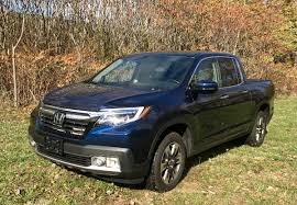2017 Honda Ridgeline: More Than Just Another Pickup Truck   BestRide 2017 Honda Ridgeline Rack And Opinion H2 Sut Red Sport Utility Truck Stock Photo Picture Royalty Free Image The_machingbird 2005 Ford Explorer Tracxlt The Gmc Graphyte Hybrid Is A Truckbranded Concept Car And Sport Hummer Rear Hatch 1024x768 Utility Vehicle Wikipedia 25 Future Trucks Suvs Worth Waiting For Subaru Outback A Monument To Success New On Wheels Groovecar Bollinger B1 Is Half Electric Suv Pickup