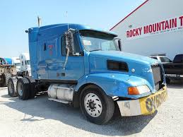100 Rocky Mountain Truck Driving School 1999 Volvo VNL64T630 Sleeper Semi