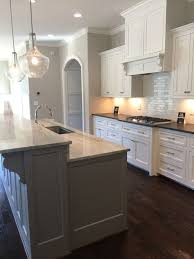SW Alabaster Cabinets Mystic Grey Satin Brushed Granite Perimeter Countertops Sea Pearl Island Light KitchenPaint WhiteBlack