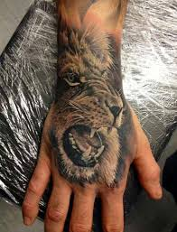 Hand Tattoos Can Be Great Attention Getters And This Realistic Lion Tattoo Has Been Brilliantly Done
