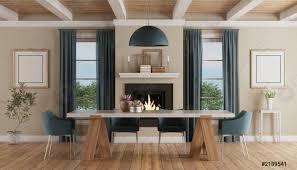 foto auf lager moderner esstisch im klassischen wohnambiente mit kamin