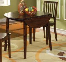 Small Round Wood Drop Leaf Kitchen Table Painted With Dark Brown Color Plus 2 Chairs For