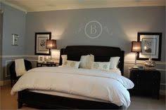 Grey Blue Bedroom With Dark Furniture