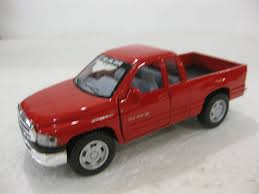 Amazon.com: Dodge Ram Quad Cab In Red Diecast 1:44 Scale By Kinsmart ...