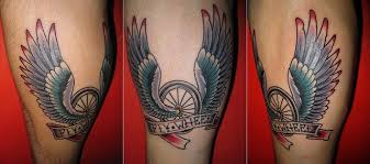 Winged Bike Wheel And Banner Tattoo