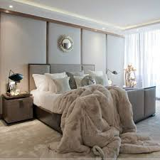 Taupe Bed Floor And A Faux Fur Blanket For Cozy Modern Bedroom Look