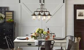 A Rustic Chandelier With Vintage Light Bulbs Over Table In Dining Room