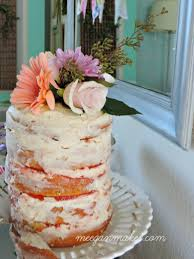 Naked Cake With Butter Cream Frosting And Raspberry