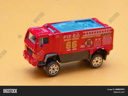 Red Toy Fire Truck Toy Fire Engine Image & Photo | Bigstock Thailands Fire Trucks Cost Big Bucks Automology Automotive Red Truck Isolated On White Stock Photo Picture And Background 3d Illustration Panning Shot Of Big Fire Truck Arriving At Airport Video Photos Images Alamy With Ladders And Hoses Red Russian Fighting Unboxing Toys Reviewdemos Engine Rescue People Engine Kids Song Music With Special Equipment 537096688 Detroit City Puredetroitcom Extras 10 Ton Capacity Gas Supply Isuzu Chassis Stc50 Generator