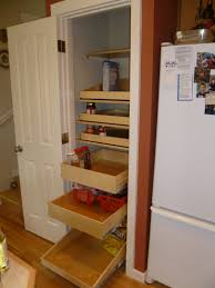 storage racks and white stained wooden frame pantry with