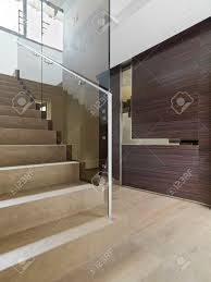 Wooden Staircase In The Modern Entrance Of Villa With Wood ... Architecture Outstanding Transparent Glass Floor Cridor Stunning Frameless Balustrade Ggs Landing Banister Staircase Oak Handrails Colour Day Interior Neutral Staircase Spiral Stairs Banister 10mm Toughened Panel Railing Exquisite Double Stairs With Chrome Burnished Nickel Inspiring For Beautiful 2014 Railing At Landing Best 25 Handrail Ideas On Pinterest Balustrade Stair Panels Staircases Reflections Range By Cheshire Mouldings In Malls Suppliers And