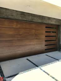 Modern Sectional Garage Door With Tinted Glass Inlay