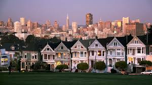 A Beautiful View Of San Franciscos Iconic Painted Ladies With The Downtown Skyline In Background