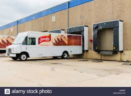 A SaraLee Bakery Delivery Truck At A Loading Dock In Oklahoma City ... New Loading Dock Improves Safety And Convience Arnold Air Force Home Nova Technology Hss Dock Solutions Assists With Downtons Alcohol Distribution Dealing Hours Vlations Beyond Your Control In Elds Forklift Handling Container Box Loading To Truck In Stock Photo White Delivery At A Picture And For Airports Saco Airport Equipment Lorry Semi Tractor Trailer Backed Up To A Brooklyn Historical Warehouse Google Search Retro Freight Trucks Lowes Logo Or Unloading At Product The Spotlight Industrieweg 2 5731 Hr Ford Driving Off Super Slowmotion High