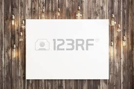 Mock Up Poster With Ceiling Lamps And A Rustic Wood Background Photo Realistic 3d Illustration