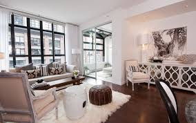 Chic City Living Room Design With White Mirrored Elisabeth Buffet Cabinet Flokati Rug Garden Stool Chocolate Brown Leather Moroccan Pouf