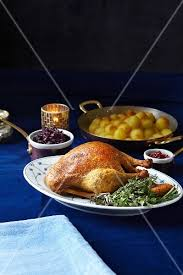 cuisine bouquet garni roast duck with a bouquet garni and side dishes buy images stockfood