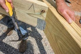 Installing Ceiling Joist Hangers by Decks Com Installing Joists On A Deck With Angles And A Flush Beam