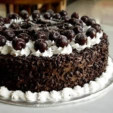 How to make black forest cake how to icing on the cake