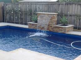 wall but curved pool patio backyard swimming