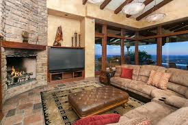 Rustic Living Room With Stone Fireplace Slate Tile Floors In On
