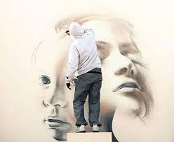 Spray Painted Wall Street Art By INO 2