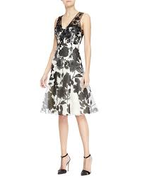 queen letizia wears carolina herrera black and white floral dress
