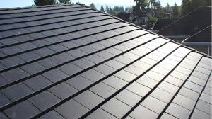 tesla expands its portfolio to produce solar roof tiles