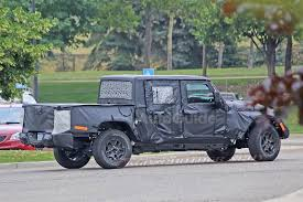 The Upcoming Jeep Pickup Truck Finally Has A Name » AutoGuide.com News 2019 Jeep Pickup Jt Strips Some Camouflage Reveals Lights And Wrangler Truck Scrambler Toronto Missauga The Upcoming Finally Has A Name Autoguidecom News Caught In Motion On Highway Long Illtrious History Of Trucks Top Speed Protype First Sight 2018 Is Coming In Maxim Hitting Showrooms April 20 Gladiator Vs Pickup Trucks From Chevy Ford Nissan 1978 J20 Off Road Truck Renderings Best Look At New La Auto Show Is Unveiled As New Suv