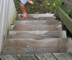 Cleaning Decking With Oxygen Bleach by Killing Algae Growing On A Wooden Deck Using Hydrogen Peroxide