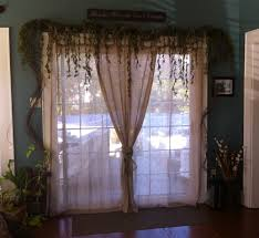 Patio Door Curtains Grommet Top by How To Decorate That Sliding Patio Door And Keep The Light