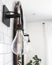 industrial bathroom sconce see this instagram photo by
