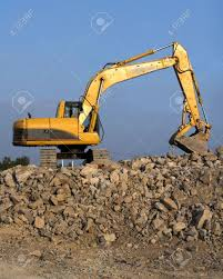 Large Track Hoe Being Used To Fill Dump Trucks With Rock To Be ...