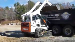 Bobcat T870 Loading Tri Axle Dump Truck - YouTube