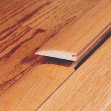 Laminate Floor Transitions To Tiles by Flush And Overlap Reducers Allow For Smooth Transitions Between