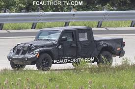 New Jeep Scrambler Spy Shots Uncover Headlights And Grille Jeep Wrangler Pickup Hitting Showrooms In April 2019 The Wranglerbased Truck Will Probably Look Like This 2018 New Spied Send The Mules 20 Scrambler Render Looks Ready For Real World Gladiator Aka Everything We Know Cars Jl Forums With Ram Truck Platform Could Underpin New Pickup Reveal Debuts At La Auto Show Will Be Named Not Upcoming Finally Has A Name Autoguidecom News Is Glorious