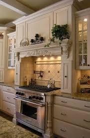 Cooking Area With Faux Mantel In A Richly Decorated French Country Kitchen Backsplash