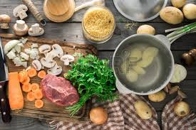 Raw Ingredients For Cooking Soup On Wooden Table Top View Rustic Style Photo