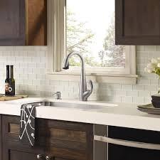 Glass Tiles For Backsplash by White Glass Tile Backsplash White Countertop With Dark Wood