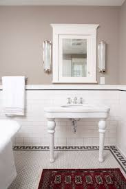 grey white black taupe bathroom with subway tile and hex house